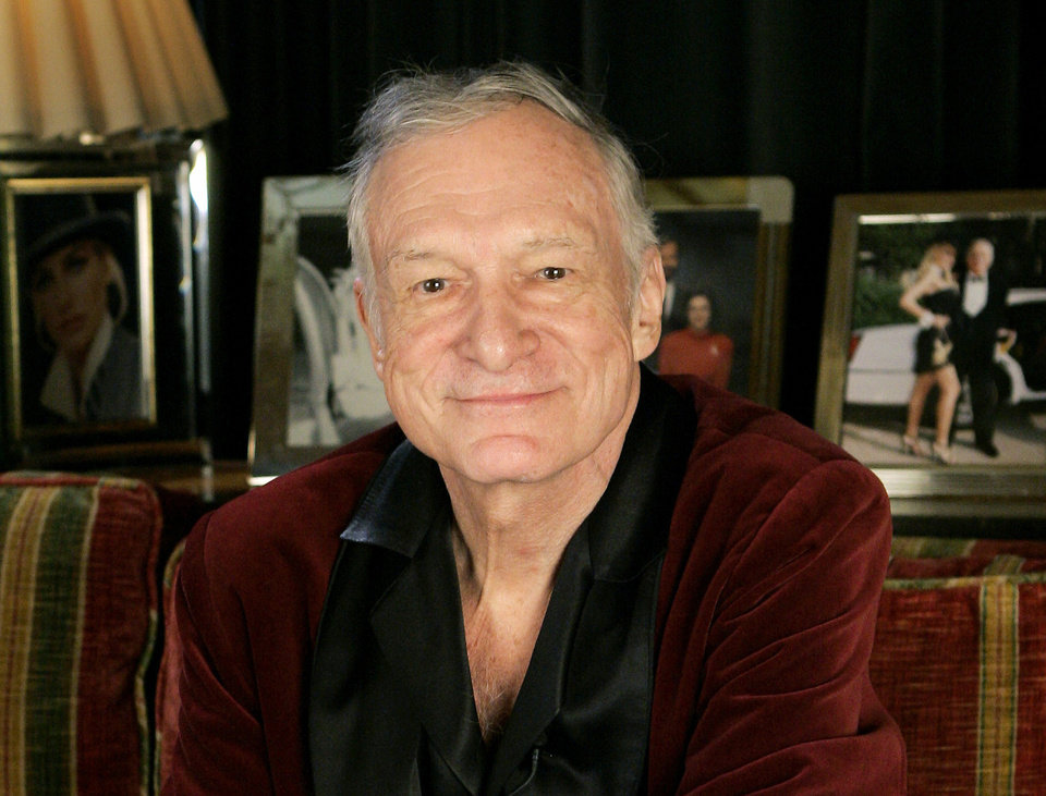 Photo - FILE - In this April 7, 2006 file photo, Playboy founder Hugh Hefner is photographed at the Playboy Mansion in the Holmby Hills area of Los Angeles. Hefner has died at age 91. The magazine released a statement saying Hefner died at his home of natural causes Wednesday night, Sept. 27, 2017, surrounded by family. (AP Photo/Kevork Djansezian, File)