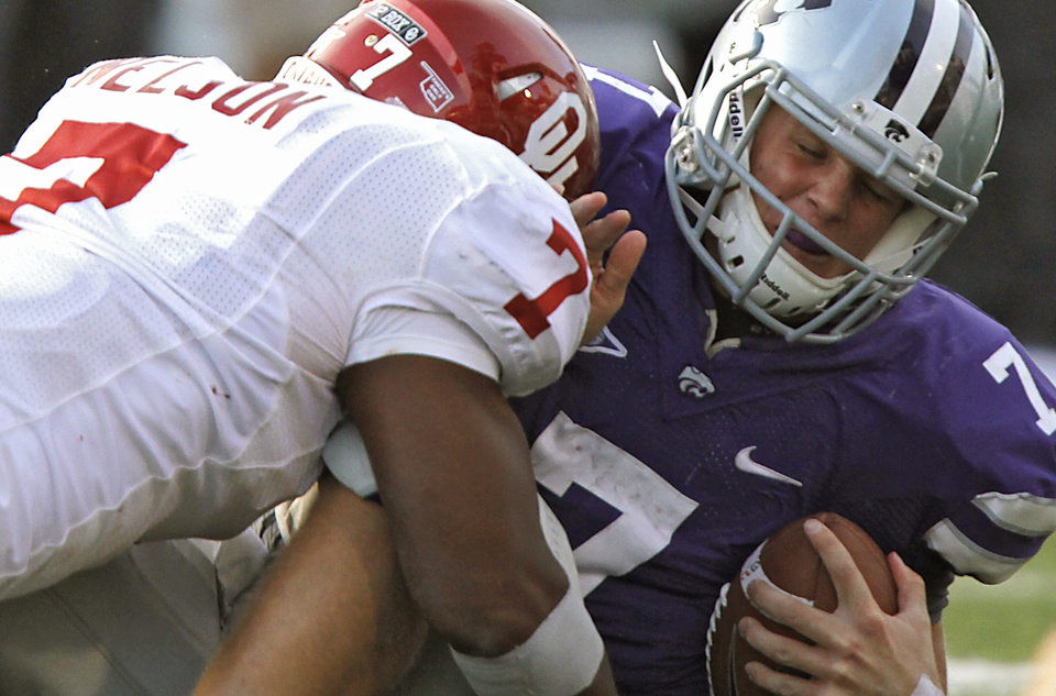 Oklahoma Sooners' Corey Nelson (7) sacks Kansas State Wildcats' Collin Klein (7) during the college football game between the University of Oklahoma Sooners (OU) and the Kansas State University Wildcats (KSU) at Bill Snyder Family Stadium on Saturday, Oct. 29, 2011. in Manhattan, Kan. Photo by Chris Landsberger, The Oklahoman  ORG XMIT: KOD