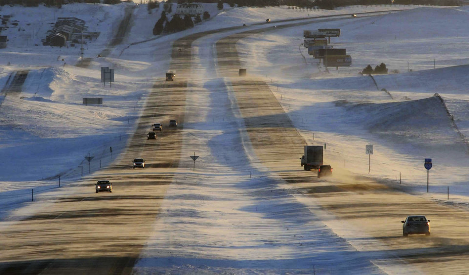 Photo - Tribune Strong winds and ground blizzard conditions greeted motorists on Interstate 94 around sunrise, Thursday, Jan. 12, 2017, west of Mandan, N.D. An Arctic cold front entered the state with winds gusting to 55 mph reducing visibility along the interstate and causing hazardous travel conditions and dangerous wind chills. (Tom Stromme/The Bismarck Tribune via AP)