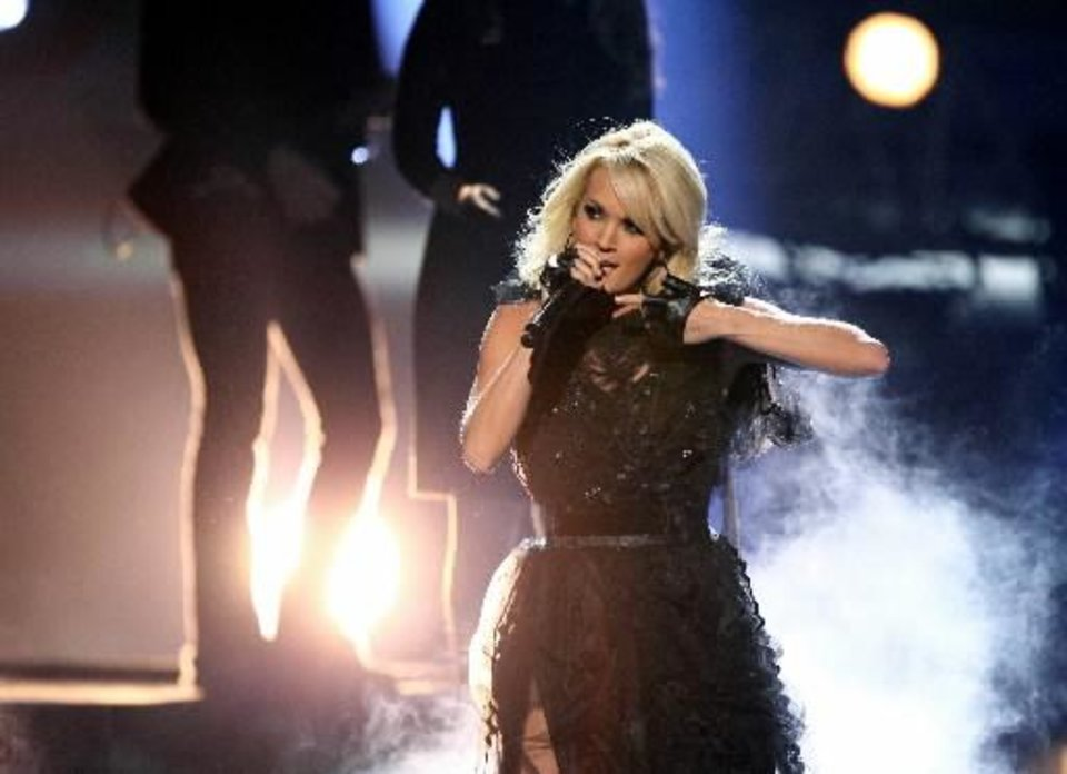 "Carrie Underwood performs her latest hit ""Two Black Cadillacs"" on the 40th Anniversary American Music Awards on Sunday, Nov. 18, 2012, in Los Angeles. The Checotah native also will perform Sunday on the 55th Annual Grammy Awards. (AP)"