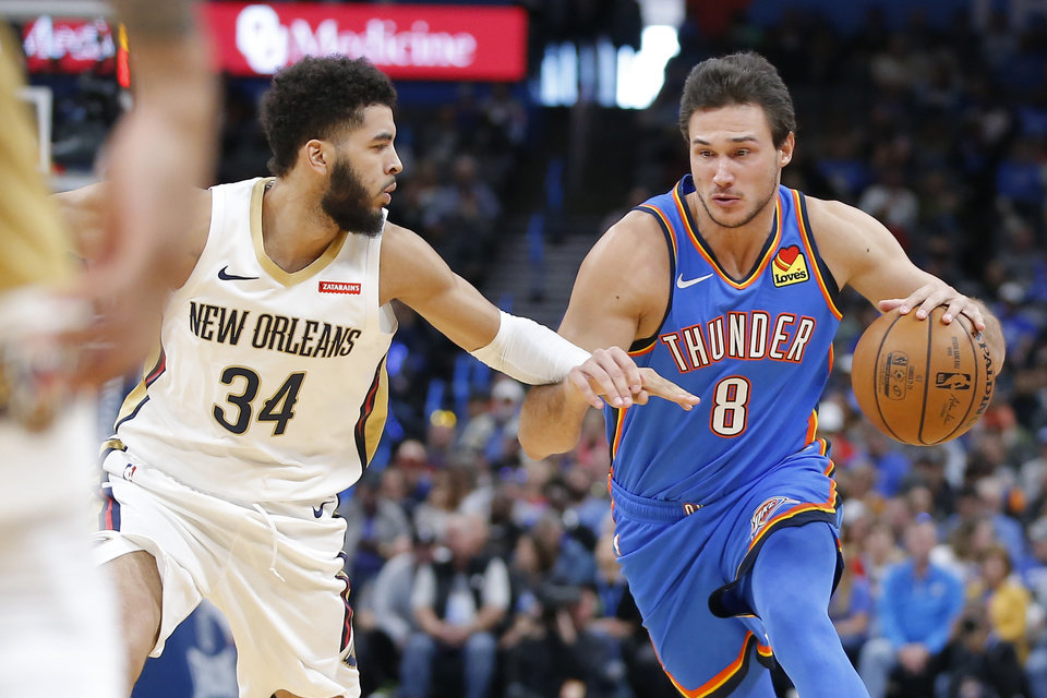 Photo - Oklahoma City's Danilo Gallinari (8) moves past New Orleans' Kenrich Williams (34) during an NBA basketball game between the Oklahoma City Thunder and the New Orleans Pelicans at Chesapeake Energy Arena in Oklahoma City, Saturday, Nov. 2, 2019. Oklahoma City won 115-104. [Bryan Terry/The Oklahoman]