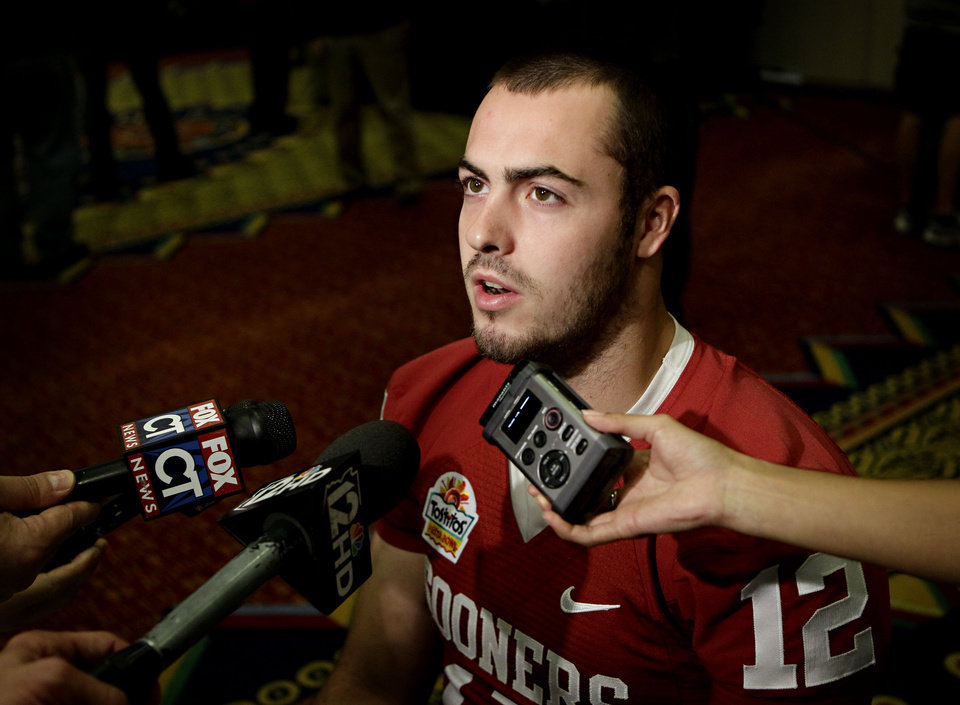 Photo - Landry Jones and the Sooners face UConn Saturday night in the Fiesta Bowl. A win could propel them toward big things in 2011. AP photo