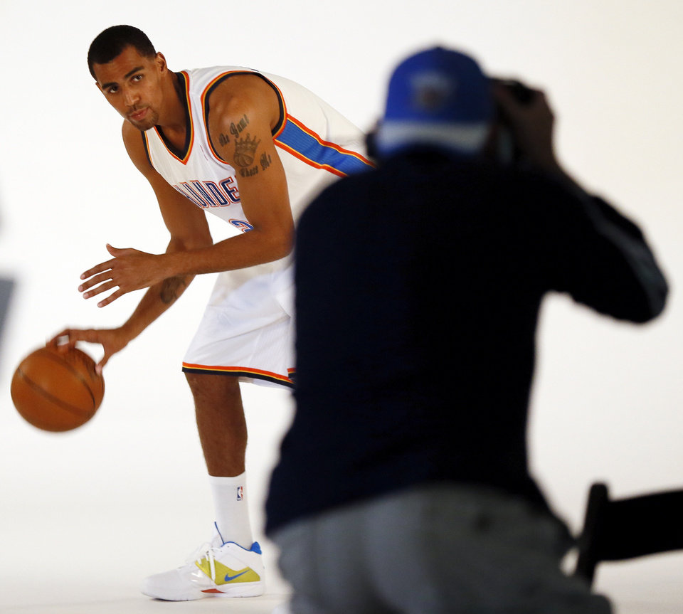 Photo - Thabo Sefolosha poses for a photo during media day for the Oklahoma City Thunder NBA basketball team at the Thunder Events Center in Oklahoma City, Monday, Oct. 1, 2012.  Photo by Nate Billings, The Oklahoman