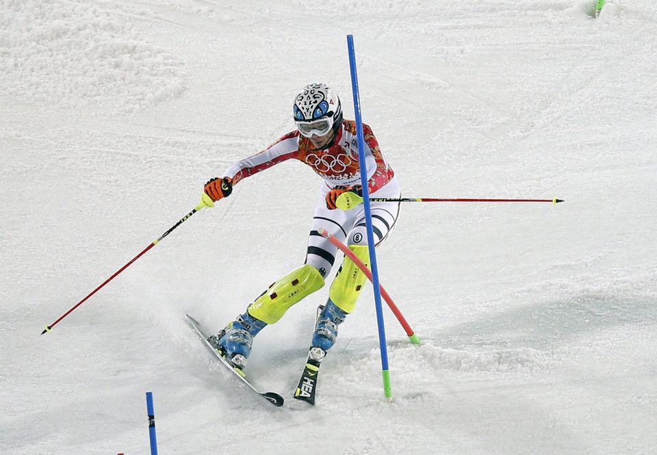 Photo - Germany's Maria Hoefl-Riesch passes a gate during the second run of the women's slalom at the Sochi 2014 Winter Olympics, Friday, Feb. 21, 2014, in Krasnaya Polyana, Russia. (AP Photo/Christophe Ena)