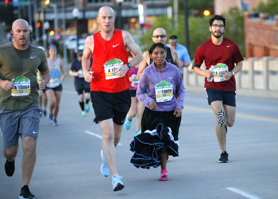 Photo - Maria Talina Ramirez Hernandez during Oklahoma City Memorial Marathon in Oklahoma City, Sunday, April 28, 2019. [Sarah Phipps/The Oklahoman]