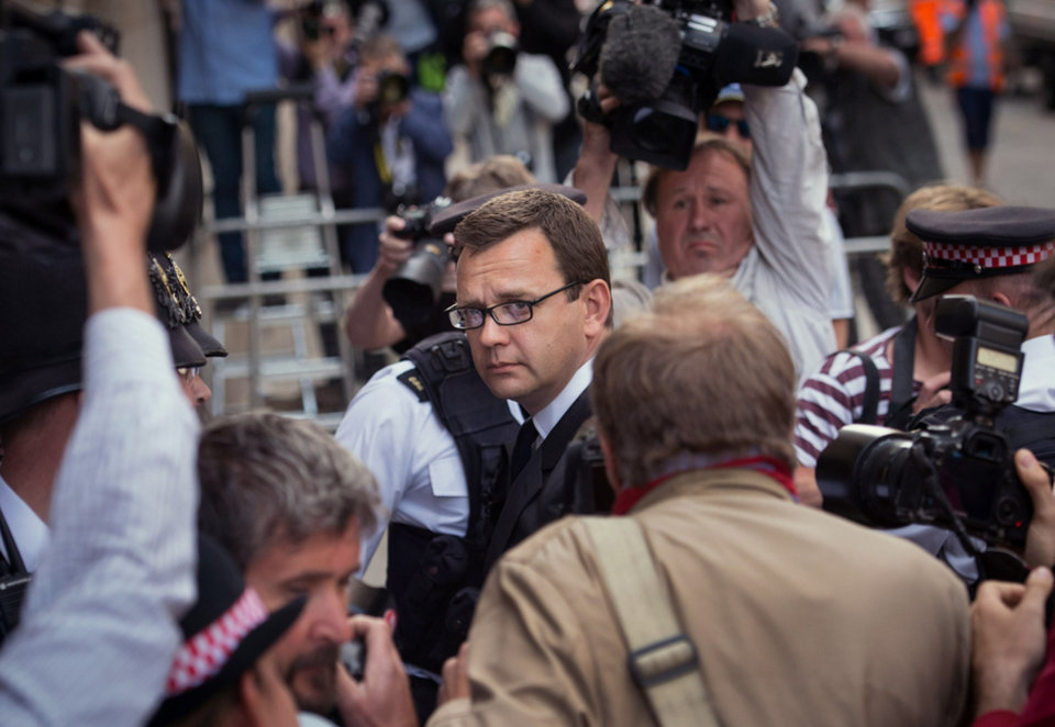 Photo - Former News of the World editor Andy Coulson, centre,  arrives at the Old Bailey court to receive his sentence, in London,  Friday, July 4, 2014. Coulson, 46, has been found guilty of being involved in the conspiracy to hack into the phone voicemails of many celebrities, royals, politicians and ordinary members of the public, at the now-closed British Sunday tabloid newspaper. Coulson has been sentenced to 18 months in jail.  (AP Photo/PA, Stefan Rousseau) UNITED KINGDOM OUT