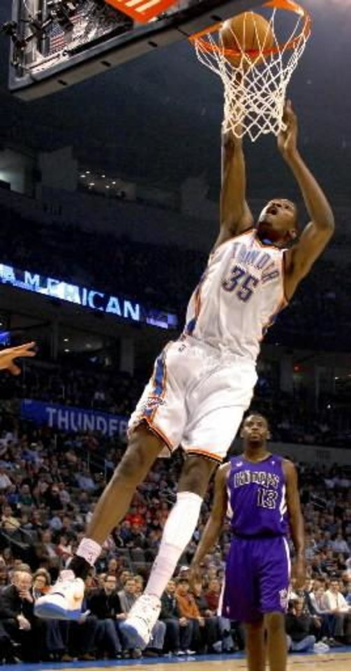 Oklahoma City's  Kevin  Durant dunks the ball over Sacramento's Tyreke Evans during the NBA basketball game between the Oklahoma City Thunder and the Sacramento Kings at the Ford Center in Oklahoma City, Tuesday, March 2, 2010. Photo by Bryan Terry