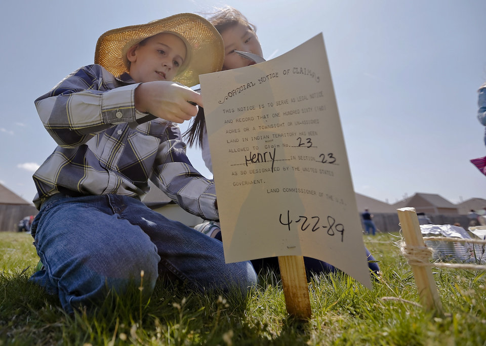 Carter Henry post his official claim note during the Oklahoma Land Run celebration at Mustang Trails Elementary on Monday, April 22, 2013, in Mustang, Okla.   Photo by Chris Landsberger, The Oklahoman