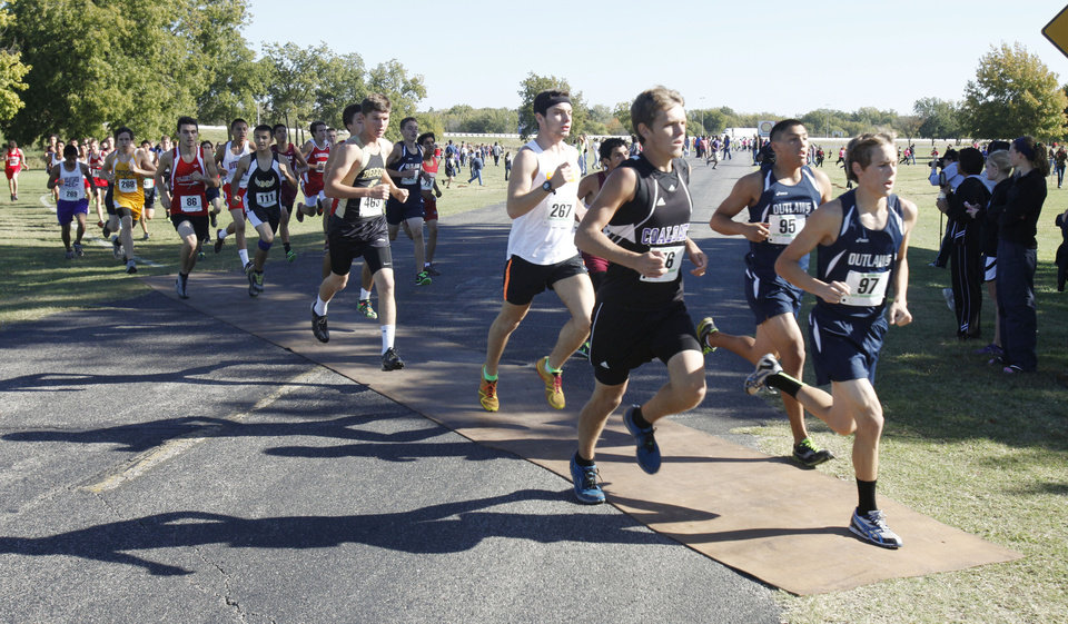 Runners pass an early section during the class 3A boy's State cross country meet at Gordon Cooper Vo-Tech in Shawnee, OK, Saturday, October 20, 2012,  By Paul Hellstern, The Oklahoman