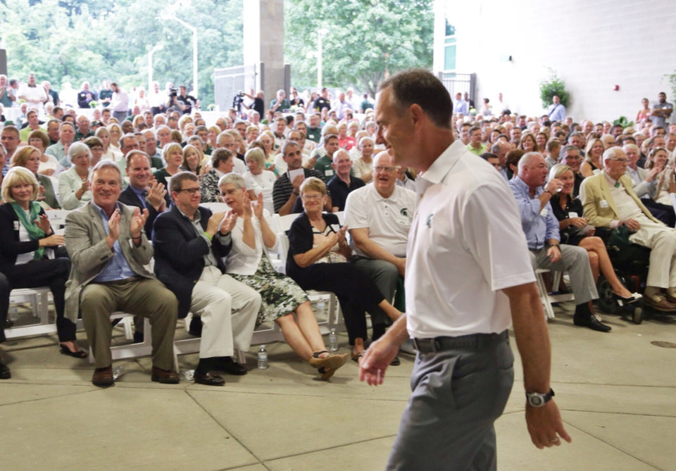 Photo - In this Monday, Aug. 25, 2014, photo, Michigan State NCAA college head football coach Mark Dantonio walks away after speaking to guests touring the the new North End Zone Complex renovations at Spartan Stadium on the Michigan State Campus in East Lansing, Mich. (AP Photo/Detroit Free Press, Ryan Garza)  DETROIT NEWS OUT, TV OUT, INTERNET OUT, MAGS OUT, NO SALES, MANDATORY CREDIT DETROIT FREE PRESS