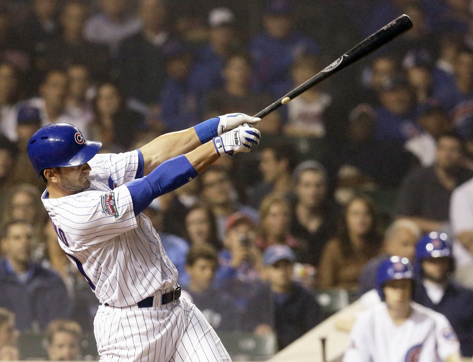 Photo - Chicago Cubs' Justin Ruggiano hits a two-run double against the Washington Nationals during the seventh inning of a baseball game in Chicago, Thursday, June 26, 2014. (AP Photo/Nam Y. Huh)
