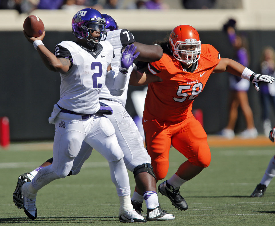Oklahoma State's Ofa Hautau (58) puts pressure on TCU's Trevone Boykin (2) during a college football game between the Oklahoma State University Cowboys (OSU) and the Texas Christian University Horned Frogs (TCU) at Boone Pickens Stadium in Stillwater, Okla., Saturday, Oct. 19, 2013. Photo by Chris Landsberger, The Oklahoman