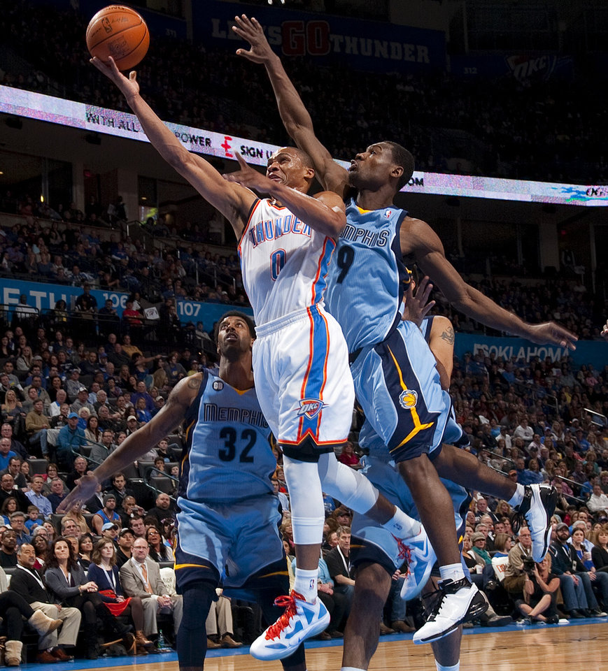 Oklahoma City's Russell Westbrook (0) goes to the basket between Memphis' O.J. Mayo (32) and Tony Allen (9) during the NBA game between the Oklahoma City Thunder and the Memphis Grizzlies at Chesapeake Energy Arena in Oklahoma CIty, Friday, Feb. 3, 2012. Photo by Bryan Terry, The Oklahoman