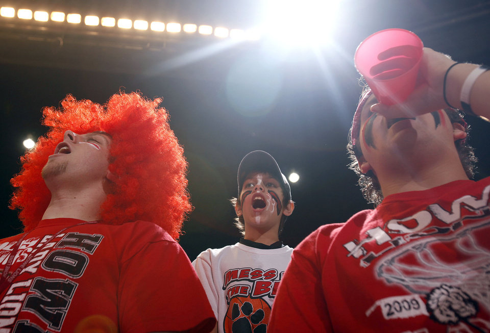 Photo - From left to right Christopher Oliver, Hunter Johnson and Waylon Turner cheer on the Howe girls during girls 2A semifinal between Howe and Newkirk at the State Fair Arena, Friday, March 13, 2009, in Oklahoma City. PHOTO BY SARAH PHIPPS, THE OKLAHOMAN
