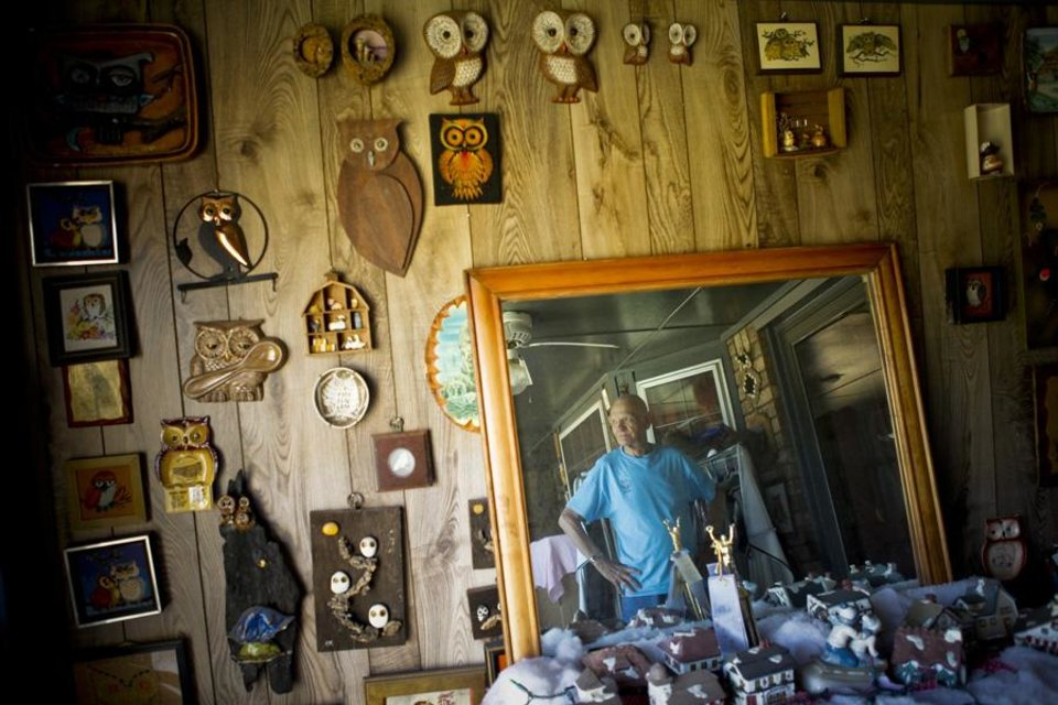 Photo -  DEAF COUPLE / MARRIED / MARRIAGE: James Paul looks around at some of the more than 6,000 owls on display in the home that he shares with his wife, Doran Barrett, on Wednesday, June 29, 2011. Both Paul and Barrett are deaf and recently celebrated their 40th anniversary. Photo by Zach Gray, The Oklahoman ORG XMIT: KOD