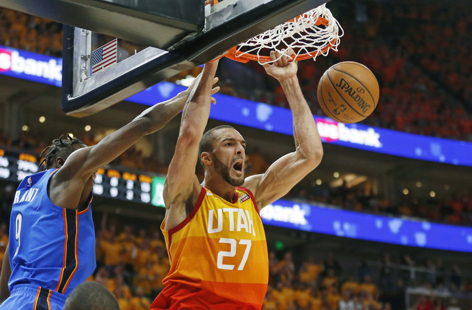Photo -  Utah Jazz center Rudy Gobert (27) dunks next to Oklahoma City Thunder forward Jerami Grant (9) during the second half of Game 3 of an NBA basketball first-round playoff series Saturday, April 21, 2018, in Salt Lake City. The Jazz won 115-102. (AP Photo/Rick Bowmer)
