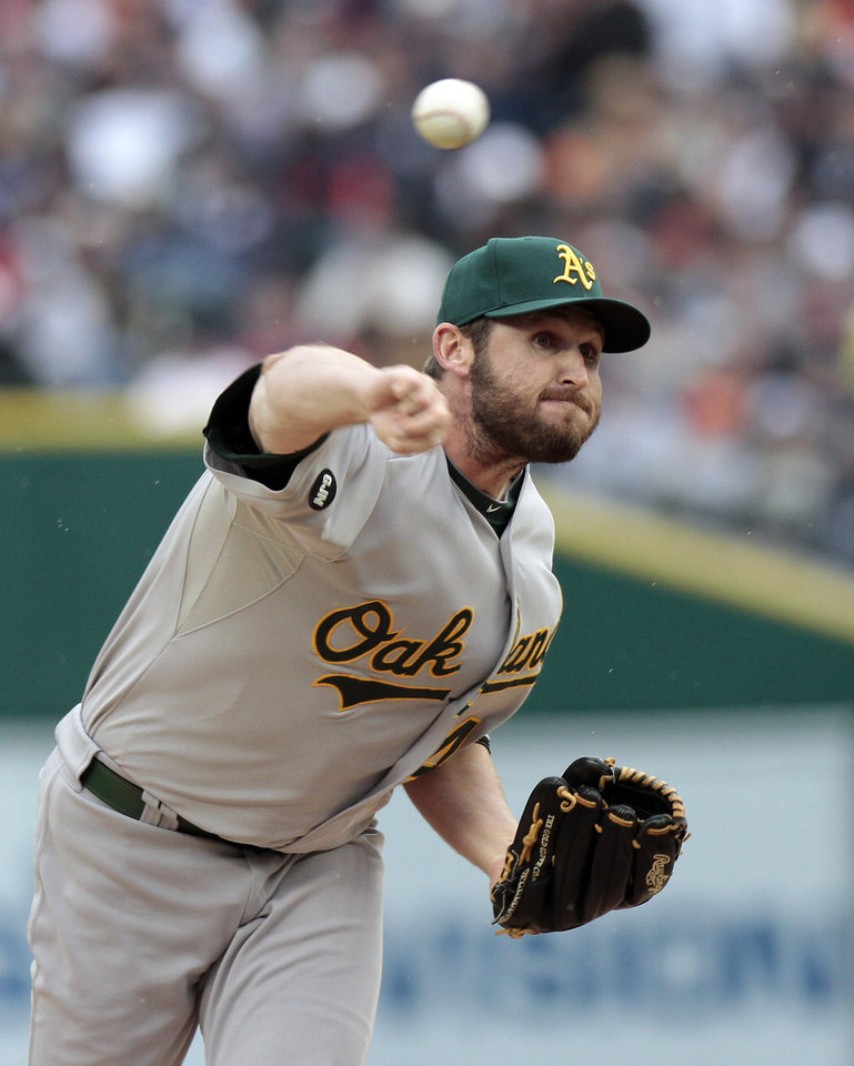 Oakland Athletics relief pitcher Ryan Cook throws during the eighth inning of Game 2 of the American League division baseball series against the Detroit Tigers, Sunday, Oct. 7, 2012, in Detroit. (AP Photo/Duane Burleson)