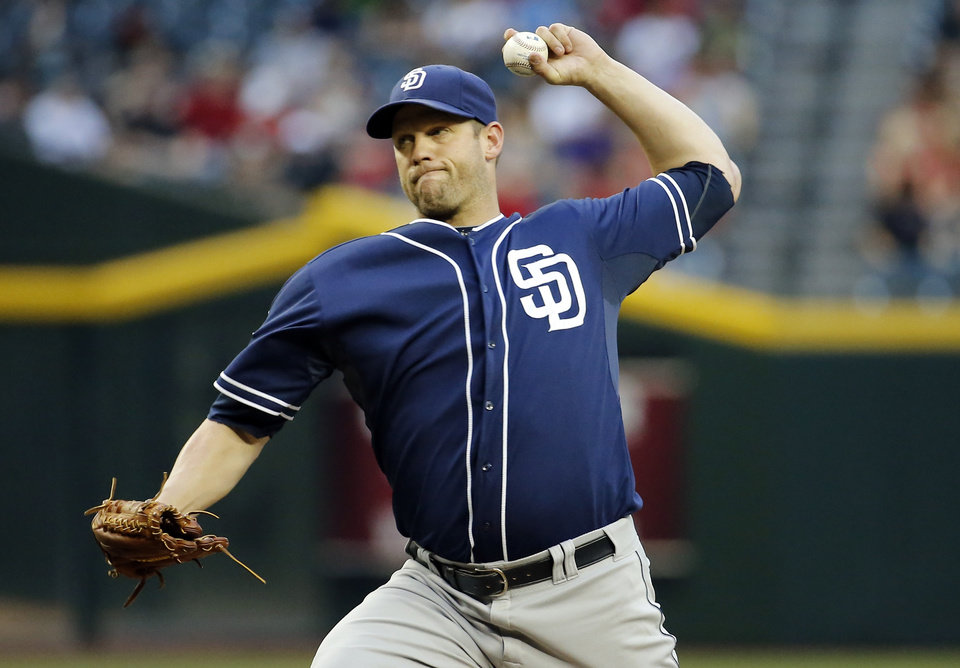 Photo - San Diego Padres pitcher Eric Stults throws during the second inning of a baseball game against the Arizona Diamondbacks, Tuesday, May 27, 2014, in Phoenix. (AP Photo/Matt York)