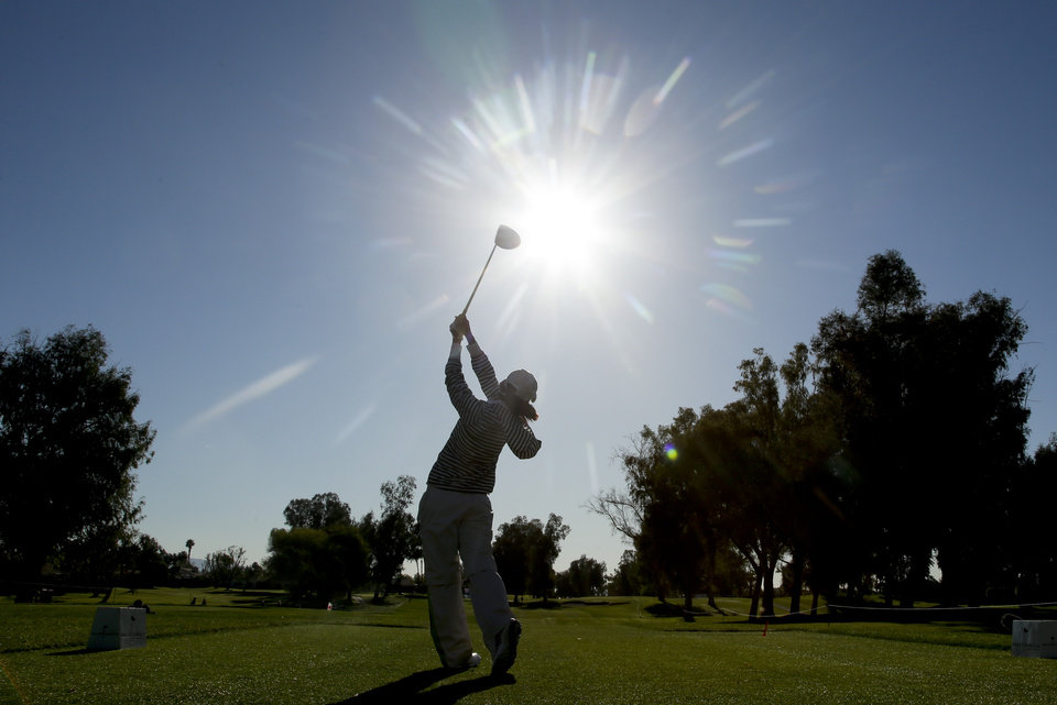 Photo - Ai Miyazato, of Japan, watches her tee shot on the 12th hole during the first round at the LPGA Kraft Nabisco Championship golf tournament Thursday, April 3, 2014 in Rancho Mirage, Calif. (AP Photo/Chris Carlson)