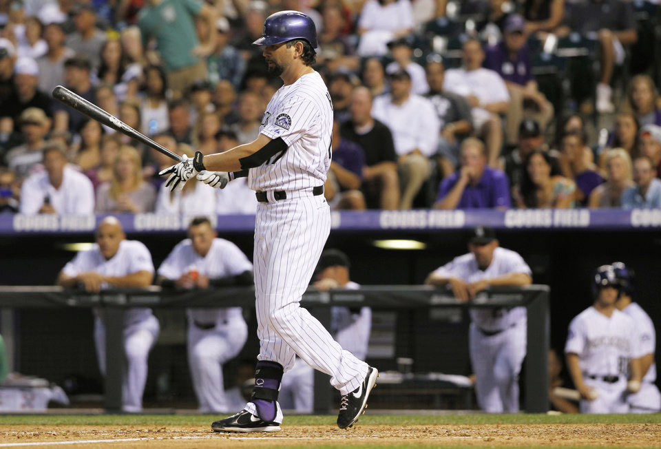 Colorado Rockies' Todd Helton reacts after striking out against the Cincinnati Redsto end the fourth inning of a baseball game in Denver on Saturday, Aug. 31, 2013. Helton is one hit shy of reaching 2,500 hits in his career. (AP Photo/David Zalubowski)