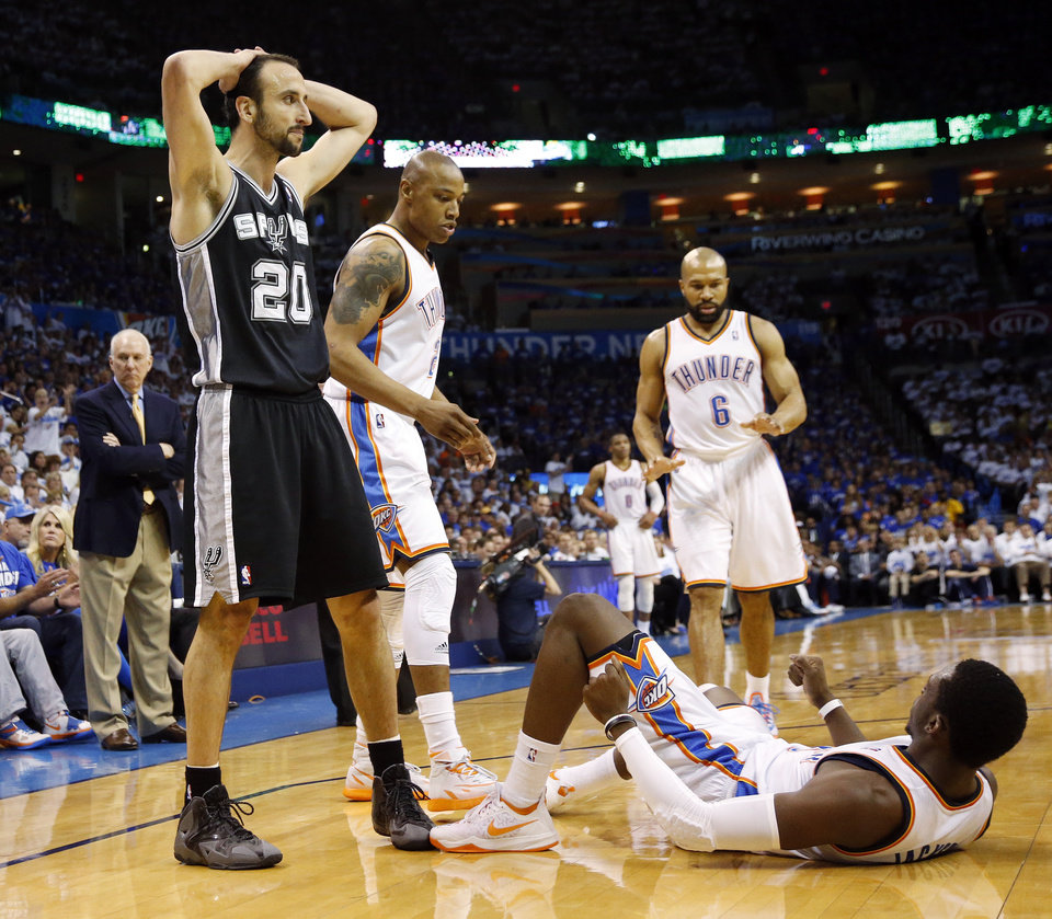 Photo - San Antonio's Manu Ginobili (20) reacts after being called for a foul near Oklahoma City's Reggie Jackson (15), lower right, Caron Butler (2) and Derek Fisher (6) in the first half during Game 4 of the Western Conference Finals in the NBA playoffs between the Oklahoma City Thunder and the San Antonio Spurs at Chesapeake Energy Arena in Oklahoma City, Tuesday, May 27, 2014. Photo by Nate Billings, The Oklahoman