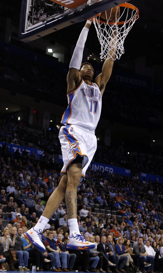 Photo - Oklahoma City's Jeremy Lamb (11) dunks the ball during the NBA basketball game between the Oklahoma City Thunder and the Orlando Magic at the Chesapeake Energy Arena, Sunday, Dec. 15,  2013. Photo by Sarah Phipps, The Oklahoman