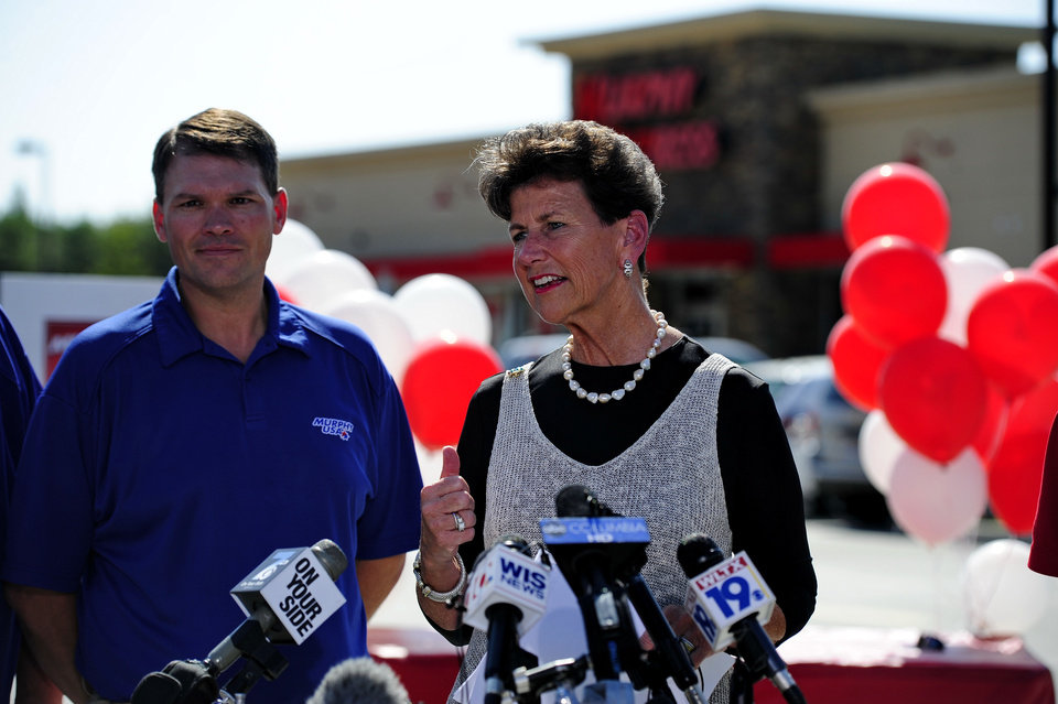 Photo - Paula Harper Bethea, right, Executive Director of the S.C. lottery and Murphy Express district manager Jason Hill speak to the media Thursday, Sept. 19, 2013, in Lexington, S.C.   A $400 million winning ticket in the latest Powerball drawing was sold at a service station just off I-20 west of Columbia, officials with the South Carolina Education Lottery said.  Winners in South Carolina do not have to come forward publicly but Bethea noted that, in order to claim the winnings, the ticketholder must contact state lottery officials within 180 days.  (AP Photo/ Richard Shiro)