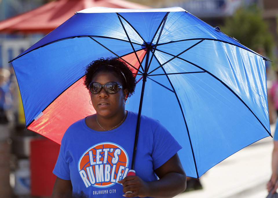 Photo - Thunder fan Tiara Hardman of Oklahoma City walks outside the arena before Game 6 of the Western Conference Finals in the NBA playoffs between the Oklahoma City Thunder and the San Antonio Spurs at Chesapeake Energy Arena in Oklahoma City, Saturday, May 31, 2014. Photo by Nate Billings, The Oklahoman