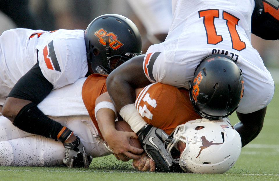 Oklahoma State's Wilson Youman (86) and Shaun Lewis (11) sack Texas' David Ash (14) during second half of a college football game between the Oklahoma State University Cowboys (OSU) and the University of Texas Longhorns (UT) at Darrell K Royal-Texas Memorial Stadium in Austin, Texas, Saturday, Oct. 15, 2011. Photo by Sarah Phipps, The Oklahoman