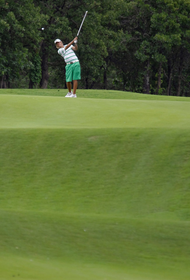 Photo - CLASS 6A HIGH SCHOOL GOLF / STATE TOURNAMENT: Edmond Santa Fe's Max McGreevy hits his approach shot on the ninth hole during the 6A golf tournament at Karsten Creek on Tuesday, May 8, 2012, in Stillwater, Oklahoma. Photo by Chris Landsberger, The Oklahoman