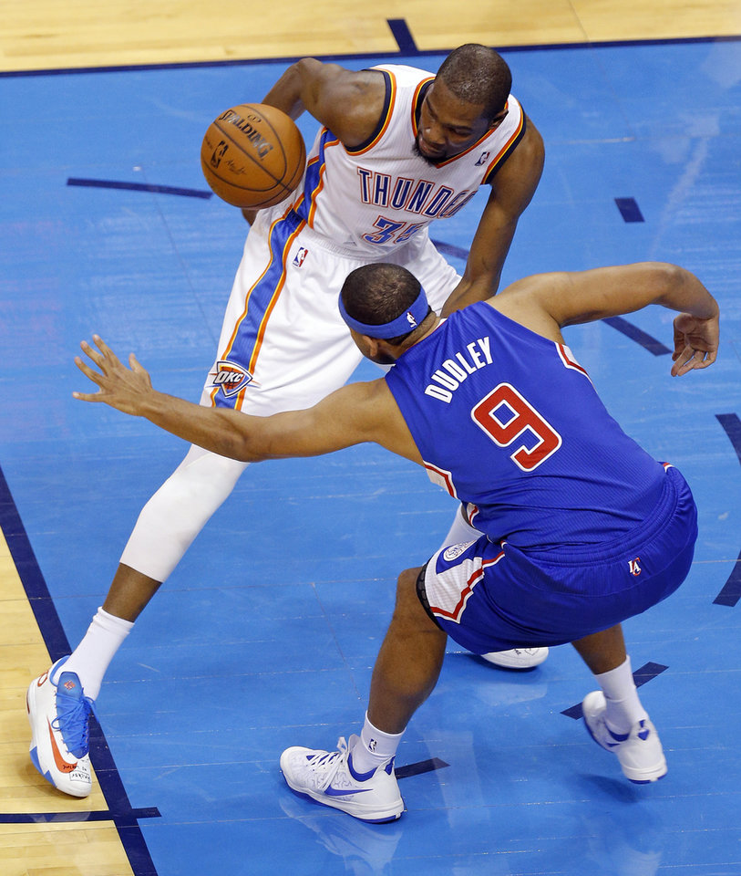 Photo - Los Angeles' Jared Dudley (9) defends Oklahoma City's Kevin Durant (35) during Game 1 of the Western Conference semifinals in the NBA playoffs between the Oklahoma City Thunder and the Los Angeles Clippers at Chesapeake Energy Arena in Oklahoma City, Monday, May 5, 2014. Photo by Bryan Terry, The Oklahoman