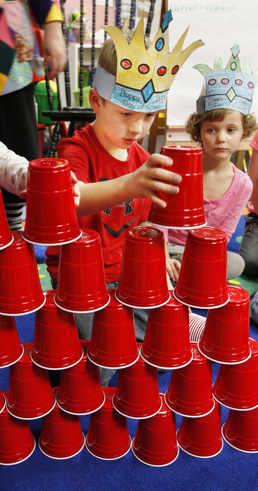 Kindergartner Cade Smith, 6, built a tower out of 100 plastic cups to celebrate the 100th day of school at James L. Dennis Elementary.  Photos by Paul B. Southerland, The Oklahoman