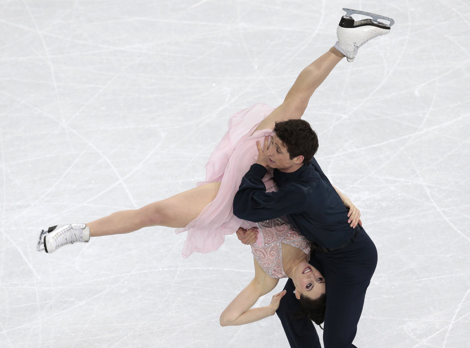 Photo - Tessa Virtue and Scott Moir of Canada compete in the ice dance free dance figure skating finals at the Iceberg Skating Palace during the 2014 Winter Olympics, Monday, Feb. 17, 2014, in Sochi, Russia. (AP Photo/Ivan Sekretarev)