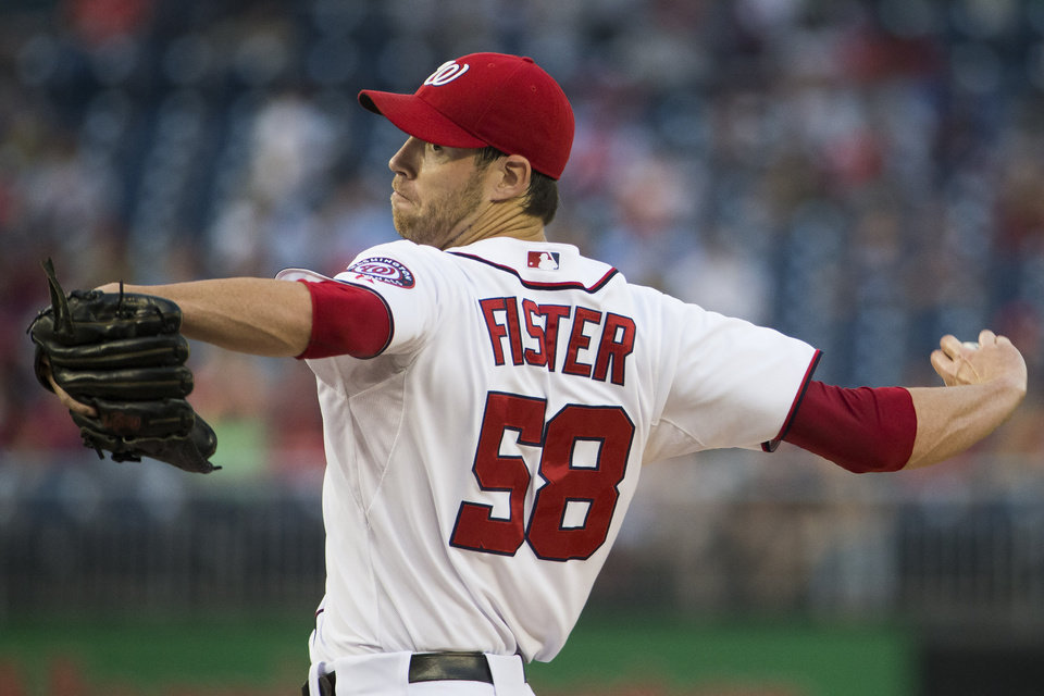Photo - Washington Nationals starting pitcher Doug Fister delivers during the first inning of a baseball game against the San Francisco Giants on Friday, Aug. 22, 2014, in Washington. (AP Photo/Evan Vucci)