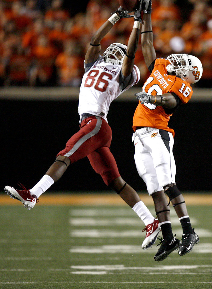 Photo - OSU's Andrae May (16) breaks up a pass intended for WSU's Marquess Wilson (86) during the college football game between the Washington State Cougars (WSU) and the Oklahoma State Cowboys (OSU) at Boone Pickens Stadium in Stillwater, Okla., Saturday, September 4, 2010. Photo by Sarah Phipps, The Oklahoman