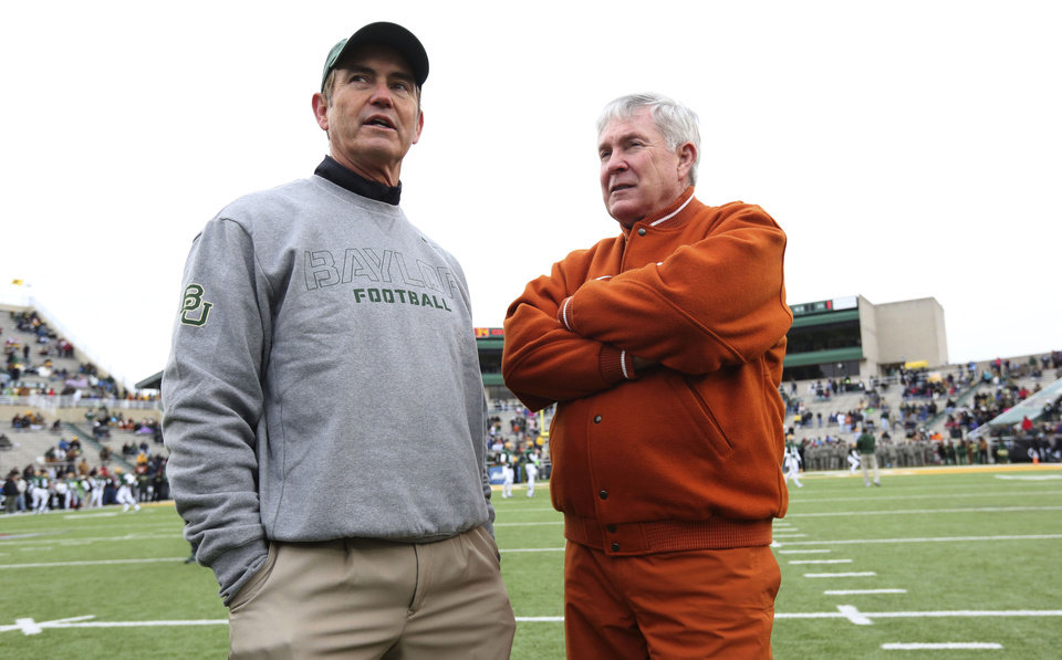 Baylor head coach Art Briles, left, visits with Texas head coach Mack Brown before an NCAA college football game Saturday, Dec. 7, 2013, in Waco, Texas.  (AP Photo/LM Otero)