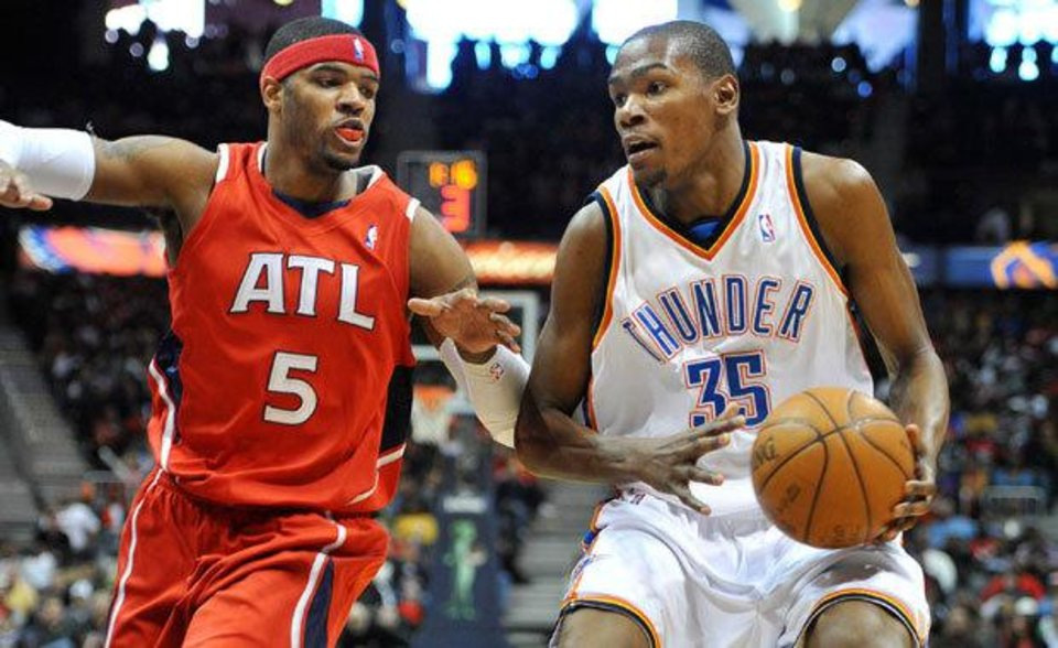Photo - Oklahoma City Thunder's Kevin Durant (35) goes to the basket against Atlanta Hawks' Josh Smith (5) in the third quarter of an NBA basketball game in Atlanta, Monday, Jan. 18, 2010. The Thunder won 94-91 and Durant scored 29 points. (AP Photo/Rich Addicks)
