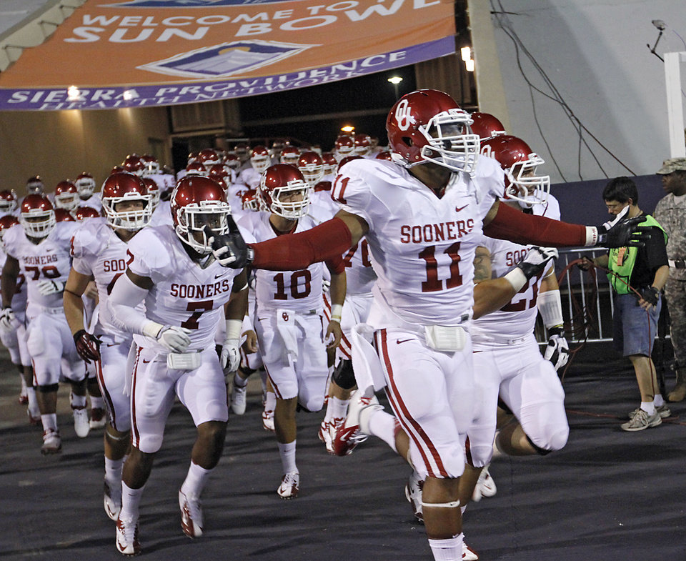 Photo - The Sooners take to the field during the college football game between the University of Oklahoma Sooners (OU) and the University of Texas El Paso Miners (UTEP) at Sun Bowl Stadium on Saturday, Sept. 1, 2012, in El Paso, Tex.  Photo by Chris Landsberger, The Oklahoman