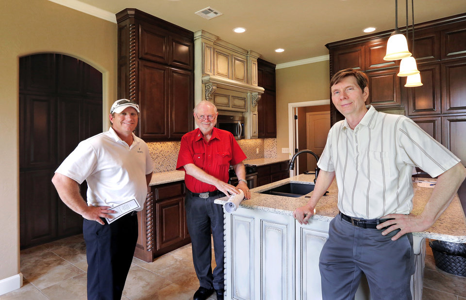 Photo -  Jason Powers, left, Bill Perry Sr. and Billy Perry Jr., at 8813 NW 10, a home by builder Jason Powers, who uses house plans by Bill G. Perry Family Design. Bill Perry started the company in 1959. PHOTO BY JIM BECKEL, THE OKLAHOMAN   Jim Beckel -  THE OKLAHOMAN