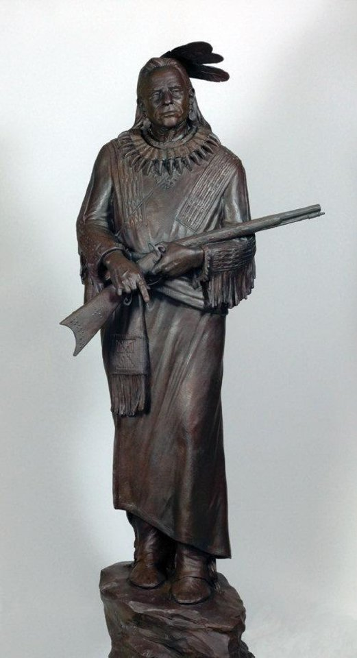 Photo - Sculptor Paul Moore's ?Finger That Kills,? priced at $36,000, depicts a Blackfeet Indian warrior holding a rifle in a hand that's missing three fingers. Moore said the life-size bronze was inspired by a gruesome, true-life event that legendary Charlie Russell talked about in one of his books. PHOTO PROVIDED