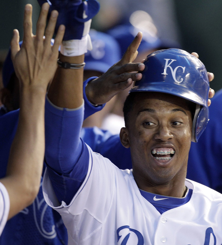 Photo -   Kansas City Royals' Alcides Escobar celebrates in the dugout after hitting a two-run home run during the third inning of a baseball game against the Detroit Tigers Wednesday, April 18, 2012, in Kansas City, Mo. (AP Photo/Charlie Riedel)