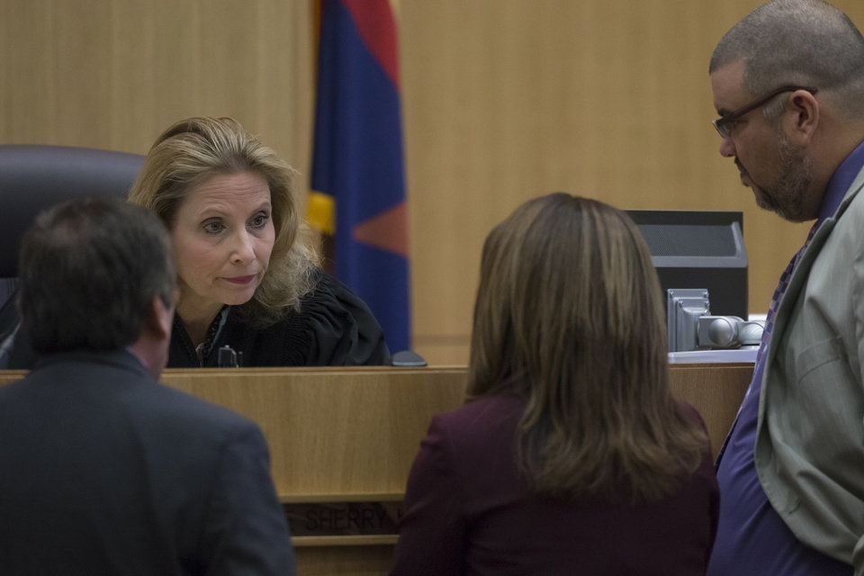 Photo - Judge Sherry Stephens, second from left, talks with prosecutor Juan Martinez, left, and defense attorneys Jennifer Wilmott and Kirk Nurmi, right, during the Jodi Arias trial at Maricopa County Superior Court in Phoenix on Thursday, April 18, 2013. Arias faces a potential death sentence if convicted of first-degree murder in Travis Alexander's June 2008 killing at his suburban Phoenix home. (AP Photo/The Arizona Republic, Mark Henle, Pool)
