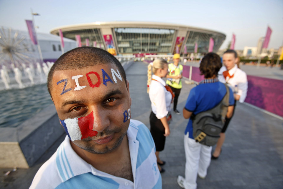 A France soccer fan stands outside the stadium before the Euro 2012 soccer quarterfinal match between Spain and France in Donetsk, Ukraine, Saturday, June 23, 2012. (AP Photo/Darko Vojinovic)