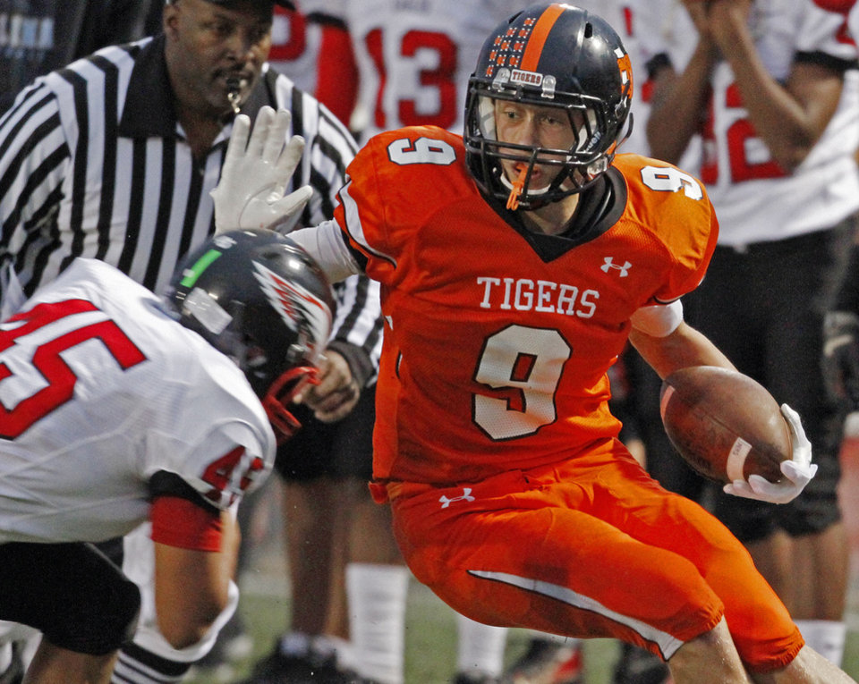 Norman\'s George Kittle, who is signing to play at Iowa, tries to stay in bounds after a catch and run as Gabriel Deluna (45) bears down as the Norman High School Tigers play the Del City Eagles on Thursday, September 15, 2011, in Norman, Okla. Photo by Steve Sisney, The Oklahoman STEVE SISNEY
