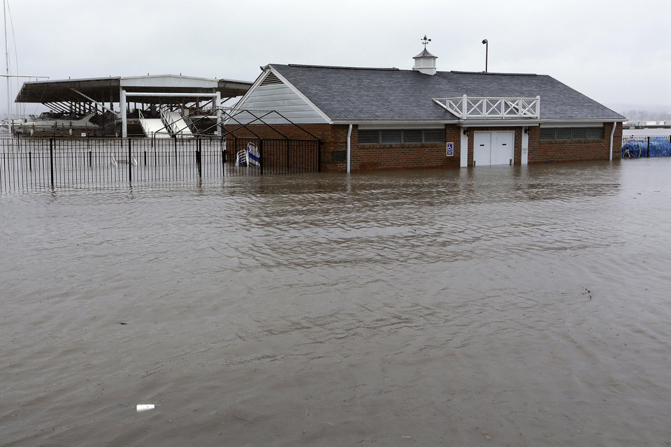 Photo - The clubhouse of the Illinois Valley Yacht and Canoe Club is surrounded by water as the Illinois River   Tuesday, April 23, 2013, in Peoria Heights, Ill. Floodwaters are rising to record levels along the Illinois River in central Illinois.   (AP Photo/Seth Perlman)