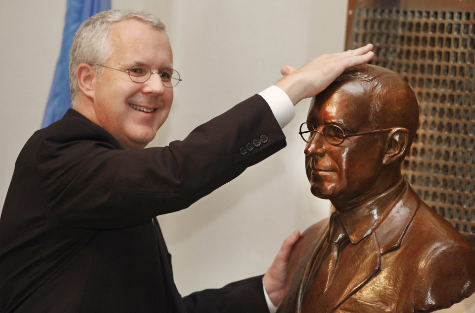 Governor Brad Henry rubs his bronze bust during an unveiling ceremony in the Hall of Governors at the state Capitol in Oklahoma City, January   , 2011. Photo by Steve Gooch, The Oklahoman