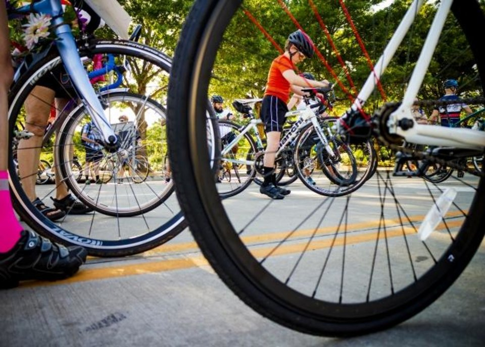 Photo -  A rider prepares for the Ride of Silence bicycle ride on May 15. A new bike law went into effect Nov. 1. Bikers hope it will prevent accidents and deaths. [Chris Landsberger/The Oklahoman]