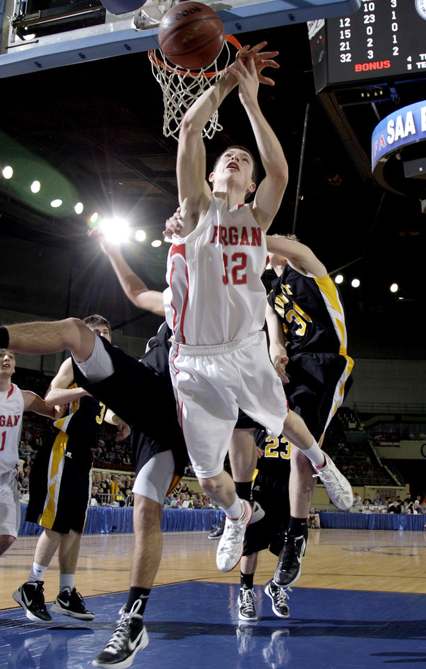 Photo - Forgan's Jace Kerr falls as he shoots during the Class B boys state championship high school basketball game  at the State Fair Arena in Oklahoma City,  Saturday, March 3, 2012. Photo by Sarah Phipps, The Oklahoman