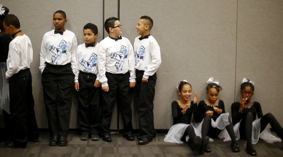 Dancers from Tulakes Elementary School rest backstage before performing at a dance competition at the Rose State Performing Arts Theatre in Midwest City. Photo by Bryan Terry, The Oklahoman BRYAN TERRY - THE OKLAHOMAN