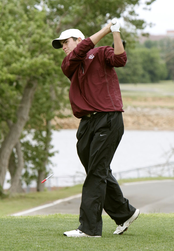 Photo - Ada's Casey Mankin tees off during the class 4A boy's state golf tournament at the Lake Hefner Golf Course in Oklahoma City, OK, Monday, May 12, 2014,  Photo by Paul Hellstern, The Oklahoman